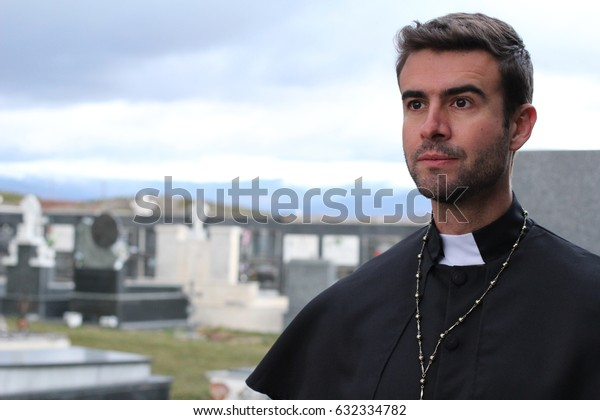 Handsome young priest close up looking away with copy space