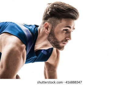 Handsome young runner in staring position