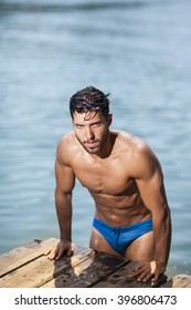 handsome young and sexy man coming out of the water.selective focus