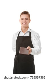Handsome young waiter with bill on white background