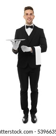 Handsome young waiter with metal tray on white background