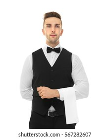 Handsome young waiter with towel on white background