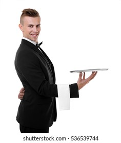 Handsome young waiter with tray on white background