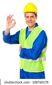 Handsome young worker gesturing okay sign in front of camera