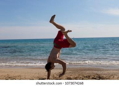 Handstand fails on beach