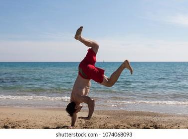 Handstand fails on a beach