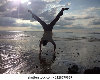 Handstand on the beach at sunset