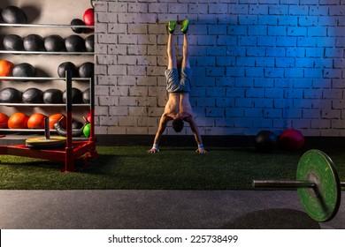 Handstand push-up man workout at gym push ups