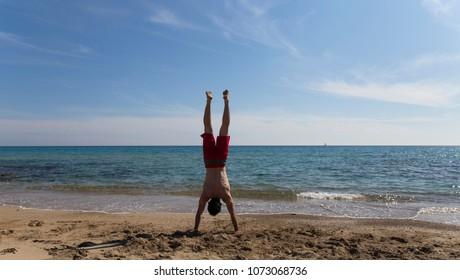 Handstanding on a gorgeous beach