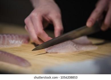 Handwork Slicing Fresh sea food, making sashimi
