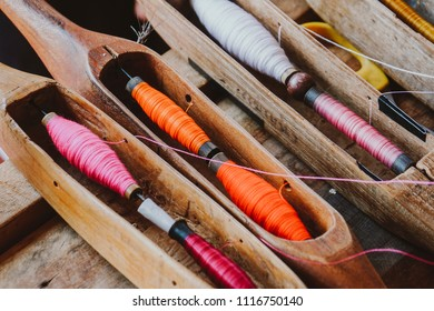 Hand-woven cotton is a folk wisdom.The device consists of Weaving shuttle,  Hand loom ,weaver.Delicate pattern This is a cultural heritage of Thailand