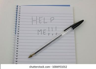 Handwriten HELP on notepad