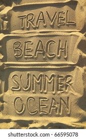 handwriten words on sand - travel, beach, summer and ocean, resort concept