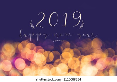 handwriting 2019 happy new year on vintage blur festive bokeh light background,holiday greeting card