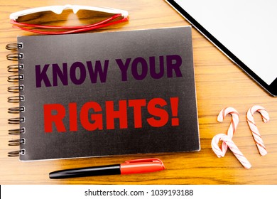 Handwriting Announcement text   Know Your Rights. Business concept for Justice Education Written on notepad notebook book with wooden background in office view with pencil marker and tablet