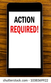 Handwriting Announcement text showing Action Required. Business concept for Immediate Urgent Written on mobile cellphone with wooden background with space on the table