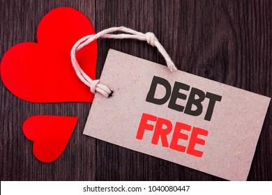 Handwriting Announcement text showing Debt Free. Business concept for Credit Money Financial Sign Freedom From Loan Mortage written on Price tag with Red words on the wooden background.