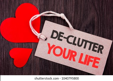 Handwriting Announcement text showing De-Clutter Your Life. Business concept for Free Less Chaos Fresh Clean Routine written on Price tag with Red words on  background.