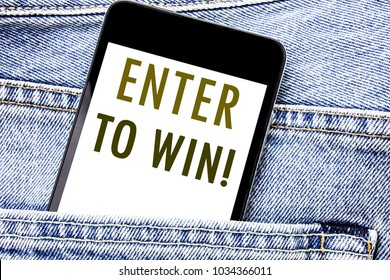 Handwriting Announcement text showing Enter to Win. Business concept for Winning in Competition Written phone mobile phone, cellphone placed in man front jeans pocket.