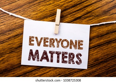 Handwriting Announcement text showing Everyone Matters. Business concept for Equality Respect written on sticky note paper on wooden background.