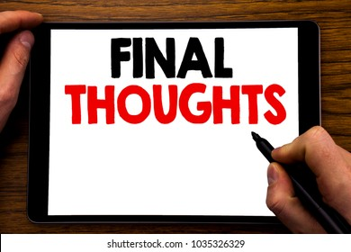 Handwriting Announcement text showing Final Thoughts. Business concept for Conclusion Summary Text Written tablet laptop, wooden background with businessman hand, finger writing on PC.