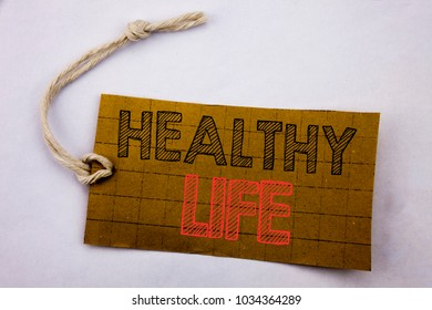 Handwriting Announcement text showing Healthy Life. Business concept for online sale Good Health Food written on price tag paper on white vintage background.