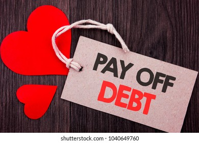 Handwriting Announcement text showing Pay Off Debt. Business concept for Reminder To Paying Owed Financial Credit Loan Bills written on Price tag with Red words on  background.