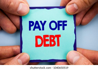 Handwriting Announcement text showing Pay Off Debt. Business photo showcasing Reminder To Paying Owed Financial Credit Loan Bills written Note Paper Holding Hand with Finger.