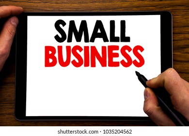 Handwriting Announcement text showing Small Business. Business concept for Strategy Management Written tablet laptop, wooden background with businessman hand, finger writing on PC.