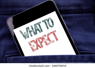Handwriting Announcement text showing What To Expect. Business concept for Achieve Expectation Written phone mobile phone, cellphone placed in man front jeans pocket.