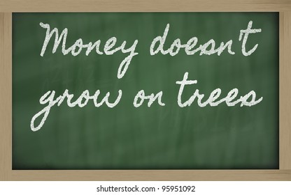 handwriting blackboard writings - Money doesn't grow on trees