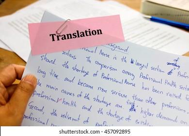 handwriting blue english words on white paper represent translating to English language