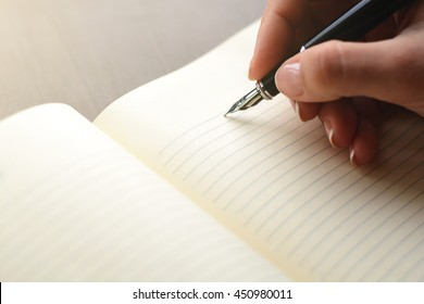 handwriting, hand writes a pen in a notebook
