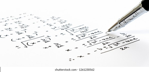 Handwriting of mathematics quadratic equation formula on examination, practice, quiz or test in maths class. Solving exponential equations background concept.