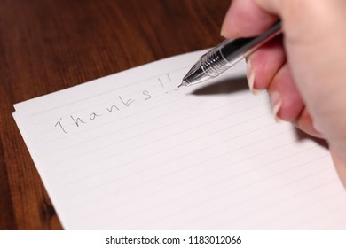 "Handwriting in the note ""Thanks!!"""