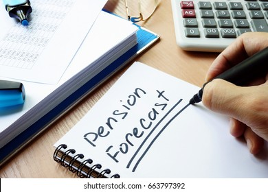 Handwriting sign pension forecast in a note.