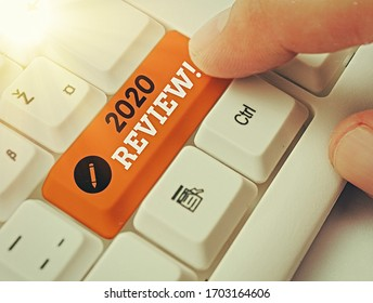 Handwriting text 2020 Review. Concept meaning remembering past year events main actions or good shows.