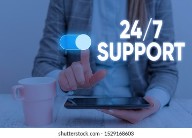 Handwriting text 24 Or 7 Support. Concept meaning Giving assistance to service whole day and night No downtime Woman wear formal work suit presenting presentation using smart device.