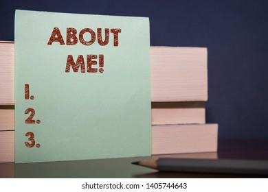 Handwriting text About Me. Concept meaning telling someone list of your good and bad properties Close up three wooden different sizes rectangle boxes paper sheet pencil.