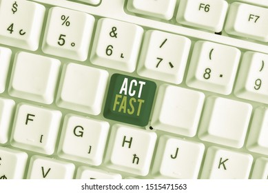 Handwriting text Act Fast. Concept meaning Voluntarily move in the highest state of speed initiatively White pc keyboard with empty note paper above white background key copy space.