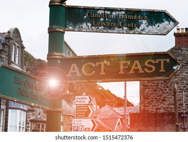 Handwriting text Act Fast. Concept meaning Voluntarily move in the highest state of speed initiatively Advertisement concept with empty copy space on the road sign.