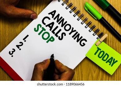 Handwriting text Annoying Calls Stop. Concept meaning Prevent spam phones Blacklisting numbers Angry caller Diary pen notepad ring pen marker pointer script daily work handwriting.