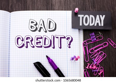 Handwriting text Bad Credit Question. Concept meaning Low Credit Finance Economic Budget Asking Questionaire written on Notebook Book on wooden background Today with Thumbpin Marker Paper Clip.