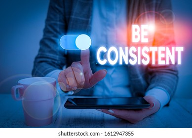 Handwriting text Be Consistent. Concept meaning Uniform Persistent Firm Unalterable Even Unchanging Rapport Woman wear formal work suit presenting presentation using smart device.