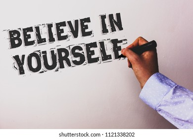 Handwriting text Believe In Yourself. Concept meaning Determination Positivity Courage Trust Faith Belief Advisors hand holding black marker whiteboard written black color words.