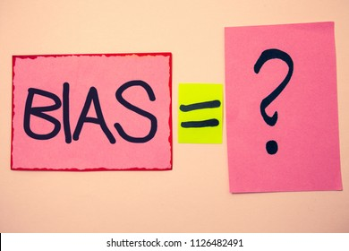 Handwriting text Bias. Concept meaning Unfair Subjective One-sidedness Preconception Inequality Bigotry Ideas messages pink papers communicate intention equal sign question mark.
