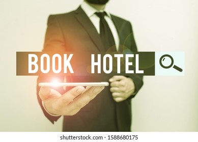 Handwriting text Book Hotel. Concept meaning an arrangement you make to have a hotel room or accommodation Male human wear formal work suit hold smart hi tech smartphone use one hand.