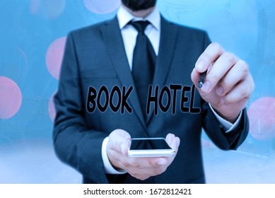 Handwriting text Book Hotel. Concept meaning an arrangement you make to have a hotel room or accommodation.