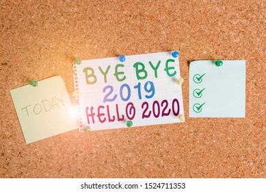 Handwriting text Bye Bye 2019 Hello 2020. Concept meaning Starting new year Motivational message 2019 is over Corkboard color size paper pin thumbtack tack sheet billboard notice board.