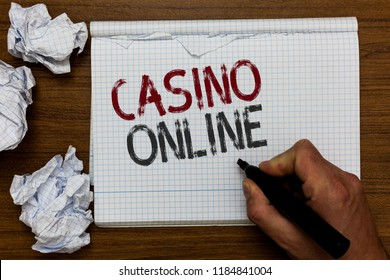 Handwriting text Casino Online. Concept meaning Computer Poker Game Gamble Royal Bet Lotto High Stakes Man holding marker notebook crumpled papers ripped pages mistakes made.